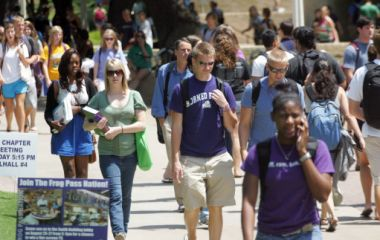 Students walk the campus of Texas Christian University in Fort Worth, ...
