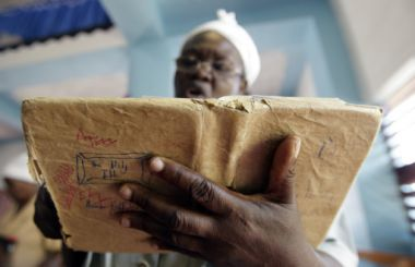A woman reads her Bible during a service in Kingston, Jamaica.