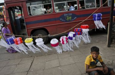 A Sri Lankan boy looks on as he awaits customers to sell decorative ...