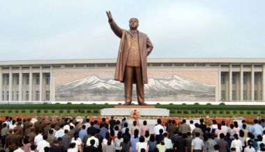 In this file photo, people stand in front of a giant statue of Kim Il ...