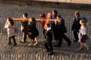A cross is carried by young people to a reception at Edinburgh Castle ...