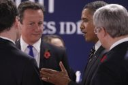 US President Barack Obama talks with British Prime Minister David ...