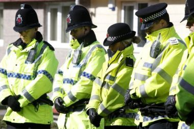 Greater Manchester Police officers observe a minute's silence near to ...