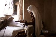 A woman making silk as part of a Christian Aid project in Afghanistan ...