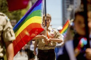 Boy Scout with rainbow flag