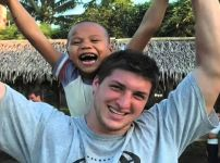 tim-tebow-with-filipino-boy