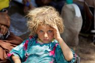 a-yazidi-girl-fleeing-islamic-state-terror-rests-at-the-iraqi-syrian-border-crossing-in-fishkhabour-dohuk