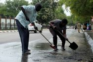 south-sudan-civilians-clean-the-streets-of-dried-blood-from-an-unidentified-soldier-who-was-killed-following-the-recent-fighting-outside-the-presidential-state-house-in-south-sudans-capital-jub