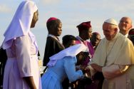 a-nun-kisses-the-hand-of-pope-francis-at-the-start-of-his-visit-to-uganda-last-year