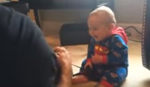 baby-amuses-parents-in-most-adorable-way-with-his-hysterical-laugh-every-time-dad-puts-his-camera-over-his-head