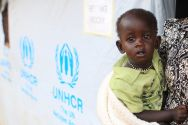 a-south-sudanese-refugee-woman-carries-her-child-at-the-unhcr-managed-refugees-reception-point-at-elegu-within-amuru-district-of-the-northern-region-near-the-south-sudan-uganda-border