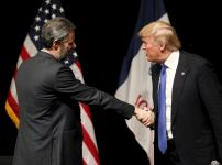 republican-presidential-candidate-donald-trump-shakes-hands-with-jerry-falwell-jr-president-of-liberty-university-at-a-campaign-town-hall-in-davenport-iowa-earlier-this-year