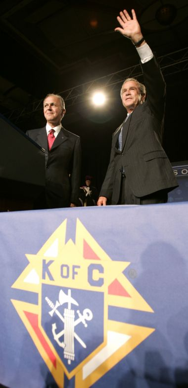 Supreme Knight Carl Anderson at the 122nd Annual Knights of Columbus convetion in Dallas, with former US President George W Bush.