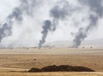 smoke-rises-from-clashes-with-islamic-state-militants-on-the-southeast-of-mosul-iraq