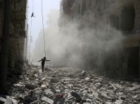 a-man-walks-on-the-rubble-of-damaged-buildings-after-an-airstrike-yesterday-on-the-rebel-held-al-qaterji-neighbourhood-of-aleppo-syria