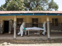 health-workers-push-a-gurney-with-a-dead-body-at-a-red-cross-facility-in-the-town-of-koidu-kono-district-in-eastern-sierra-leone-during-the-ebola-crisis