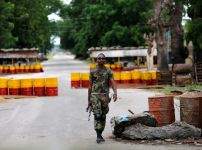 a-soldier-walks-past-a-checkpoint-in-bama-borno-state-nigeria