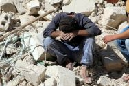 a-man-mourns-relatives-killed-yesterday-in-the-latest-airstrike-on-the-rebel-held-al-qaterji-neighbourhood-of-aleppo-in-syria