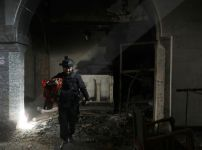 a-christian-iraqi-special-forces-soldier-walks-in-a-newly-liberated-church-in-bartella-east-of-mosul