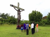 school-girls-pray-in-front-of-a-crucifix-at-their-school-in-kakoge-north-of-ugandas-capital-kampala-in-october-last-year