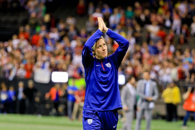 Abby Wambach walks off the field after her final appearance for the US against China PR.