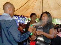 pastor-spraying-insecticide-on-worshipper