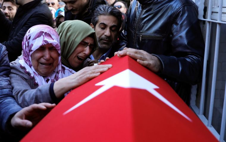 Relatives of Fatih Cakmak, a security guard and a victim of an attack by a gunman at Reina nightclub, react during his funeral in Istanbul,