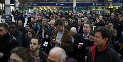 passengers-queue-at-victoria-station-london