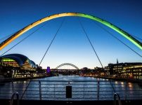 gateshead-millennium-bridge-glows-green-and-yellow-as-traidcraft-launch-charity-campaign