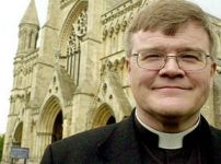 dr-jeffrey-john-poses-outside-st-albans-cathedral