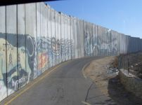 The Israeli security wall has become a major obstacle to empoylment ...