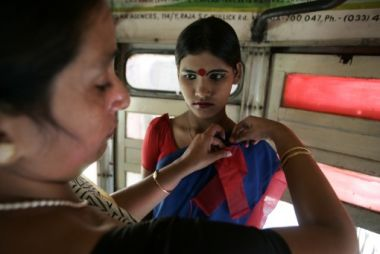 A volunteer puts a Red ribbon on an Indian sex worker during an AIDS ...