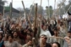 Pakistani protestors hold sticks as they chant anti Denmark slogans ...